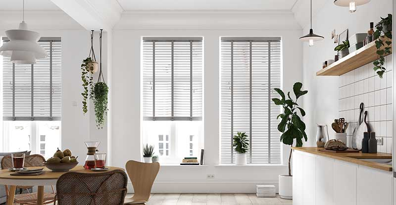 Open plan kitchen with faux wood waterproof wooden blinds
