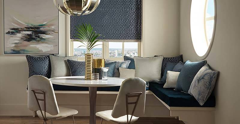 Blue patterned roman blind in a dining room window