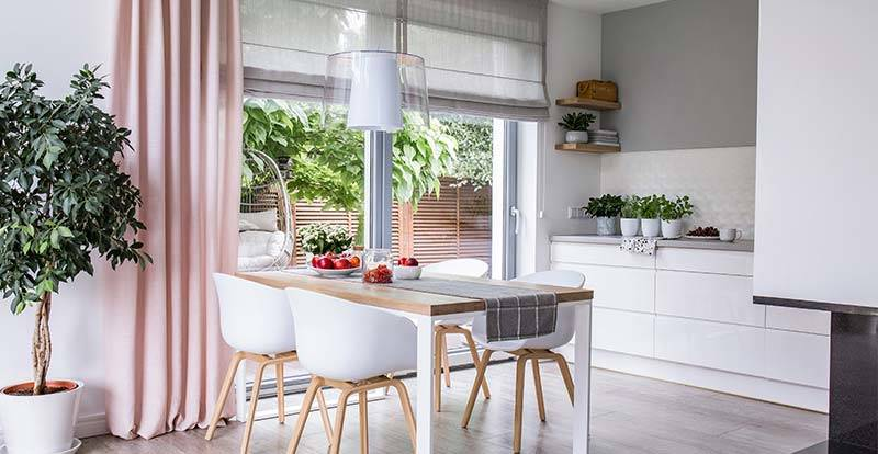 Pink curtains and grey roman blinds in kitchen French doors