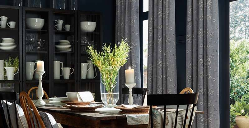Blue patterned curtain in a kitchen dining area