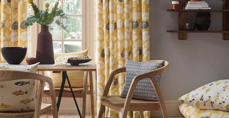 Yellow patterned full length curtain in a dining area patio door