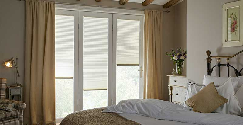 Pleated door blinds