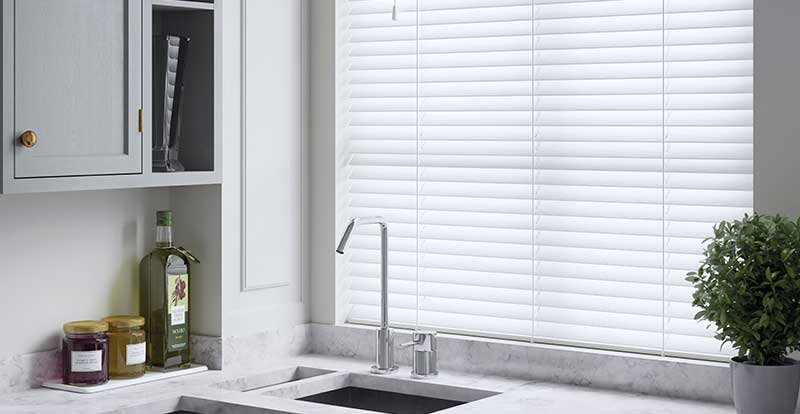 White Faux wooden blind in a kitchen.