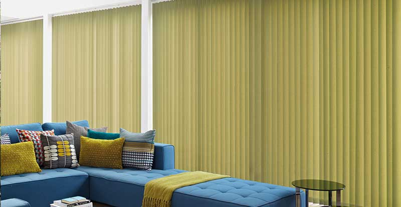 Green vertical blinds spanning across french doors