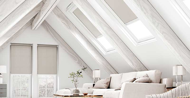 Grey velux blinds in a loft.