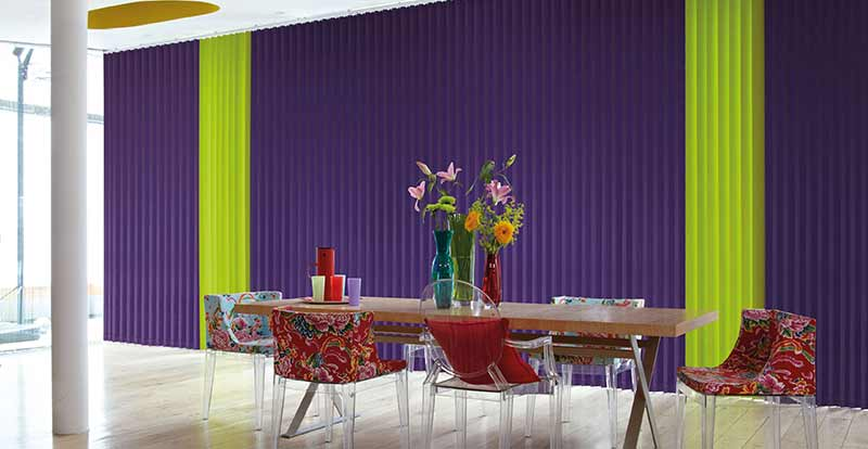 Green and purple vertical blind in a dining room.