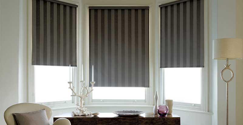 Striped roller blind in a living room