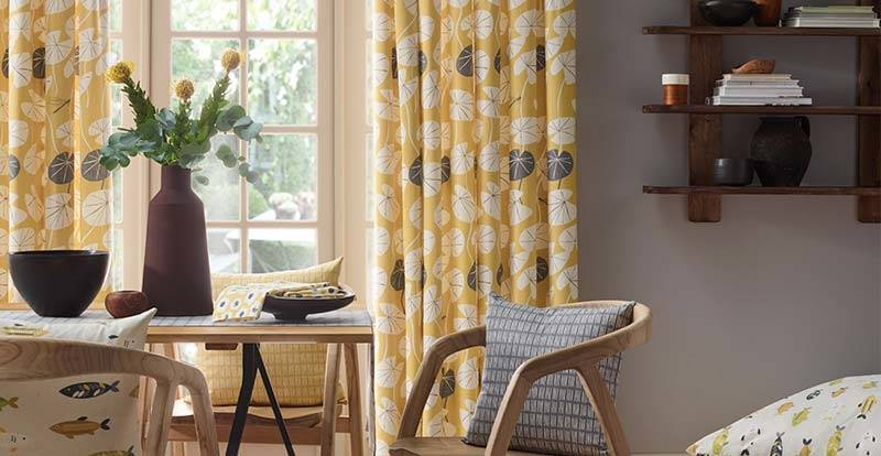 Yellow patterned curtains in a kitchen patio door