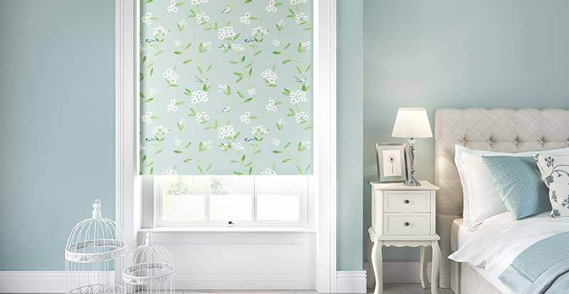 Blue patterned blackout roller blind in a large bedroom window