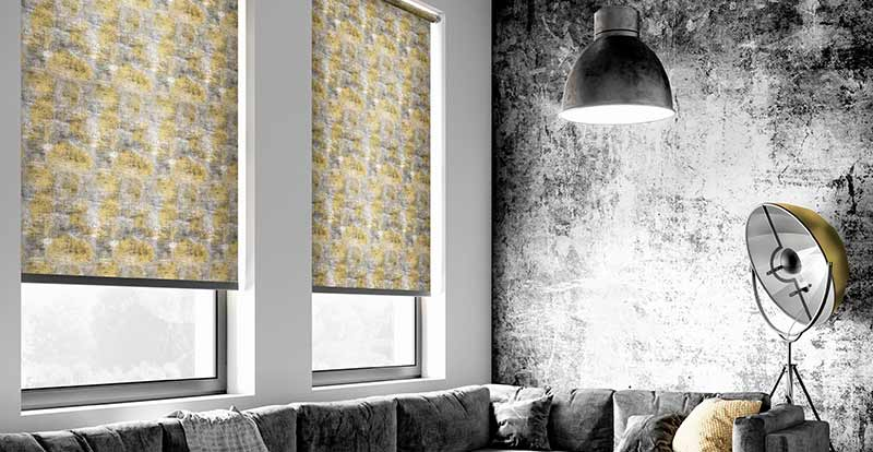 Modern grey and yellow Roller blinds in a living room.