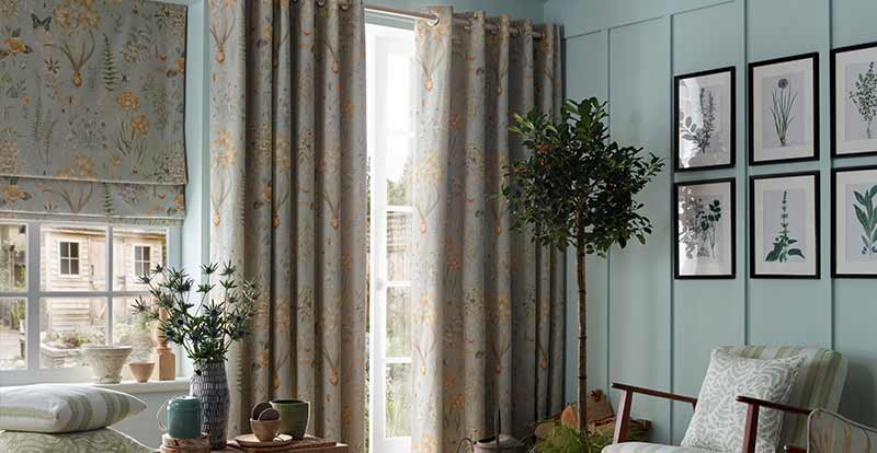 Rosella Seaspray Roman blind and curtain in a living room.
