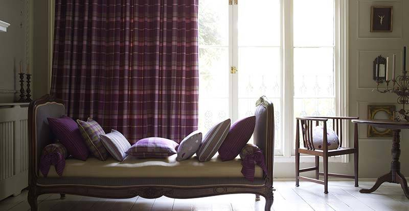 Purple striped full length curtain.