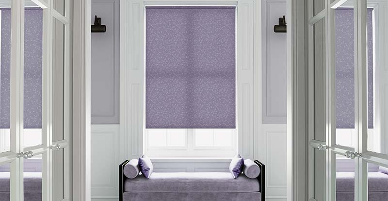 Patterned purple roller blind in a hallway