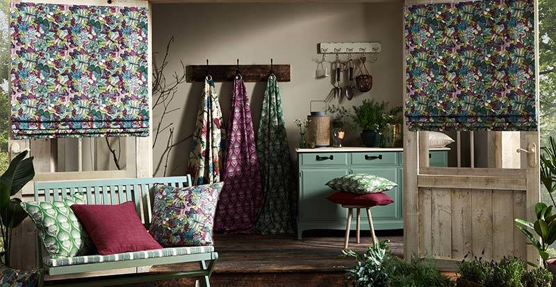Patterned roman blinds in a shed