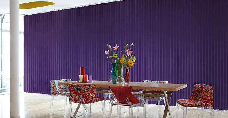 Purple vertical blinds in a dining room
