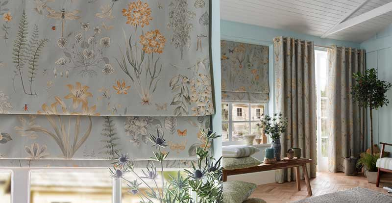 blue floral roman blinds showing a stack or open roman