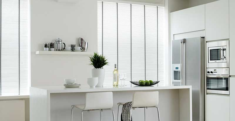 White wooden blind with grey tapes in a kichen
