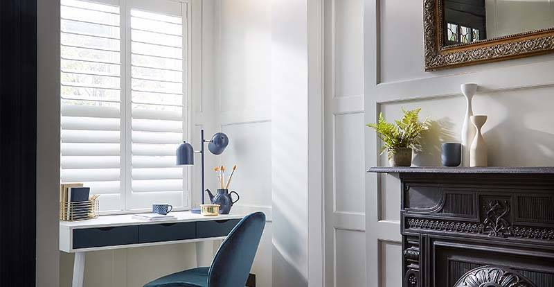 Café style white shutters in a home office