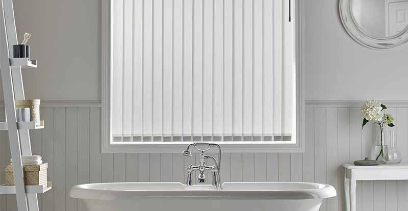 White Vertical Blinds showing louvres, or, slats.