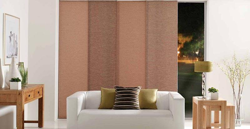 Brown panel blind in a living room