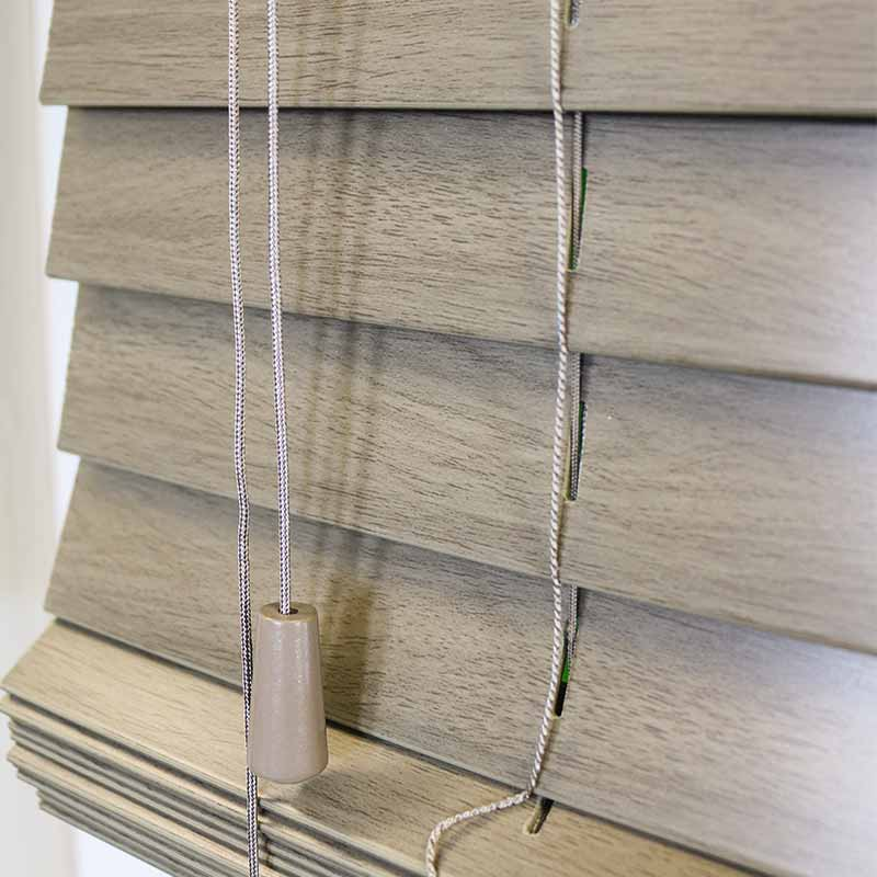 Grey Faux Wooden Blind Showing a Control Toggle