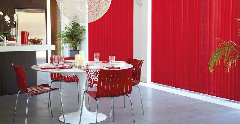 red blackout vertical blind in a dining room