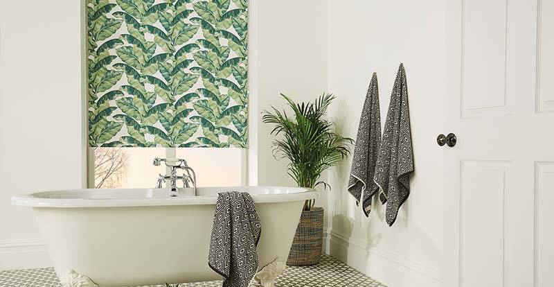 Tropical blackout roller blind in a bathroom.