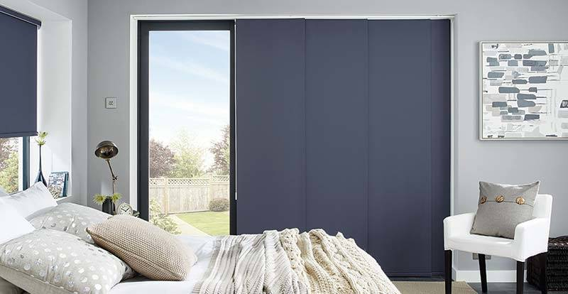 Blue blackout panel blind in a bedroom.