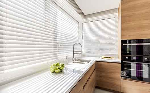 White wooden blind in a large kitchen window