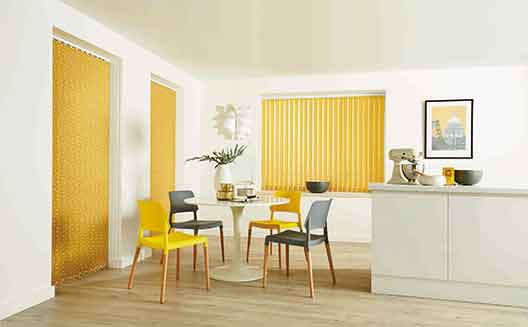 Yellow vertical blind in a large kitchen window