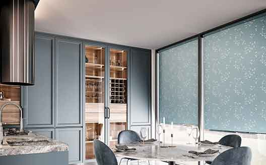 Blue roller blind in a full height dining room window.