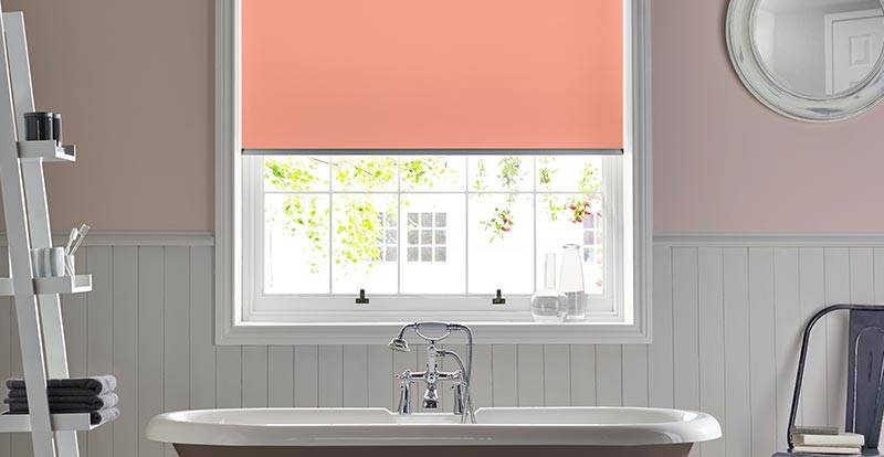 Coral Orange Electric Roller Blind in a bathroom