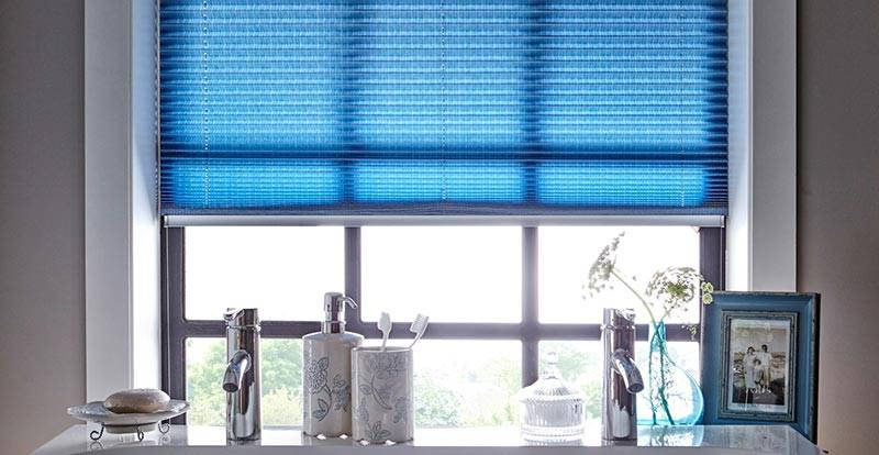 Blue Pleated blind in a Bathroom Window