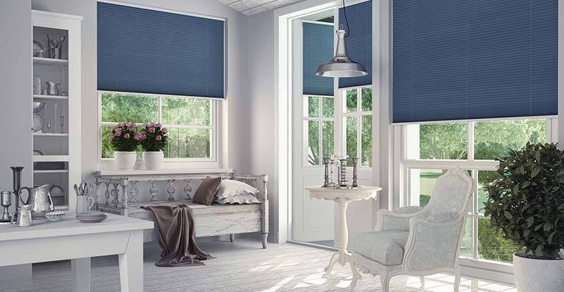Blue Neat Fit Pleated Blinds in a Conservatory