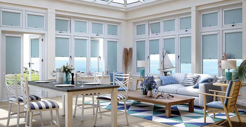 Light Blue Perfect Fit Roller Blinds in a Conservatory