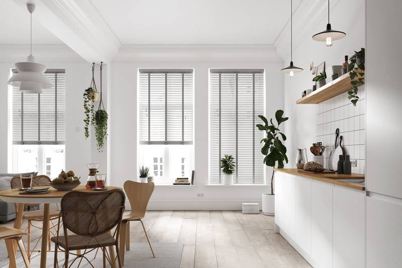 White real wood taped blinds in large open space dining room