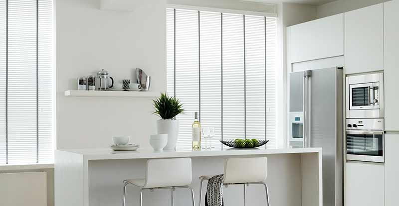 White taped wooden blinds in a dining room