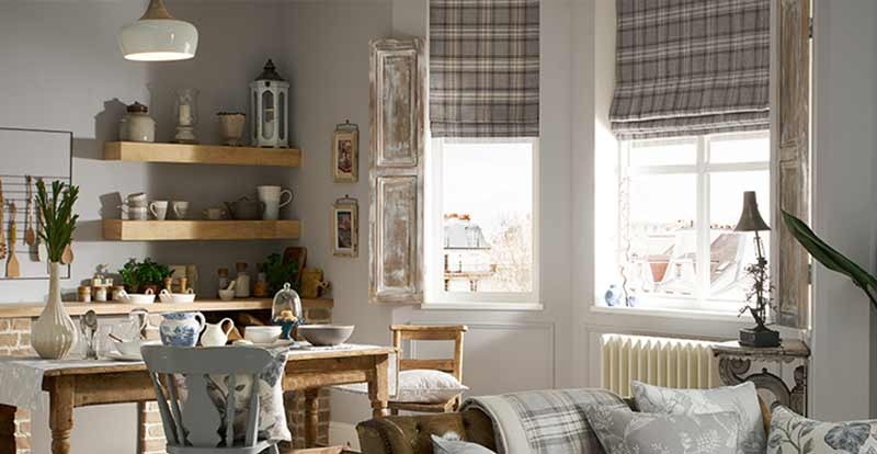 Checked Roman blinds in a dining room