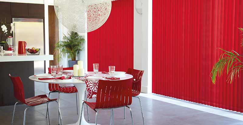Red Vertical blinds in a dining Room