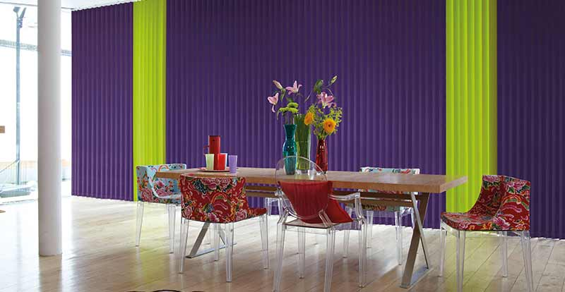 Green and Purple Mixed Vertical Blind Slats in a dining room