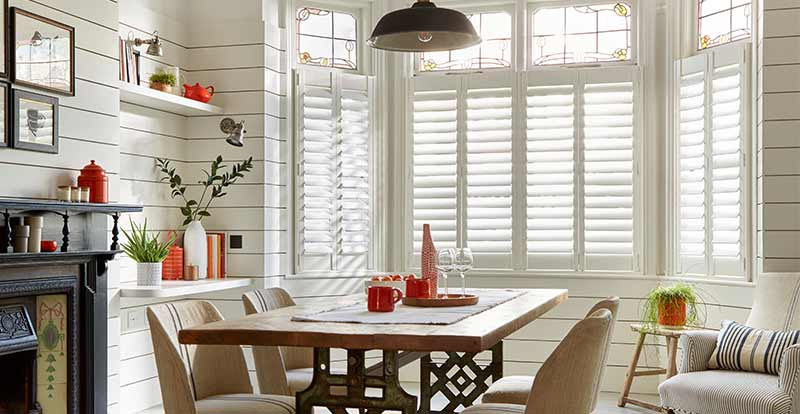 White shutters in a contemporary dining room