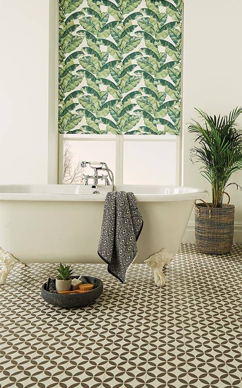 Palm leaf roller blind in a bathroom