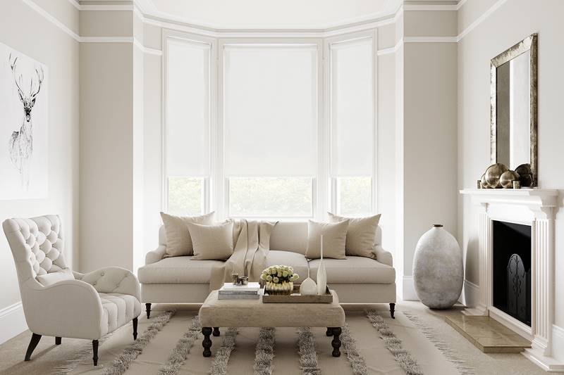 Blackout white roller blinds in large living room windows