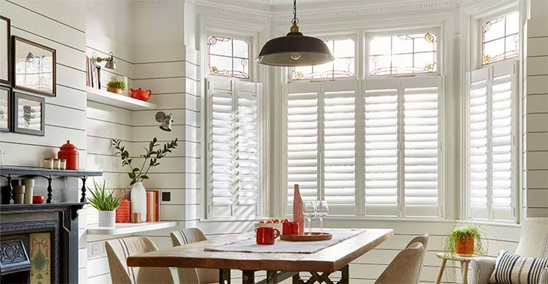 White cafe Shutters in a dining room