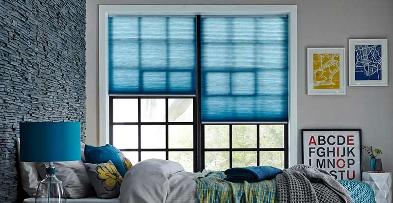 Thermal Pleated Blinds in a bedroom.
