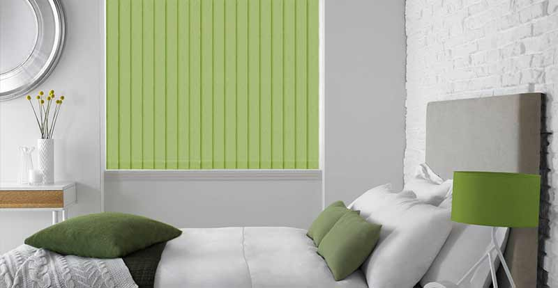 Thermal green vertical blind in a bedroom.