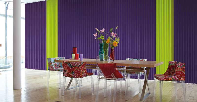 Thermal Green and Purple Vertical blind slats in a dining room.