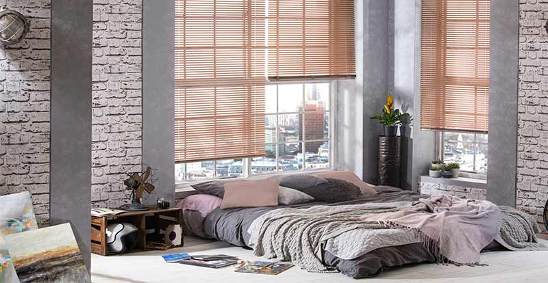 Rose gold venetian blind in a bedroom