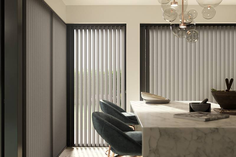 Grey full length vertical blind in a large living room window