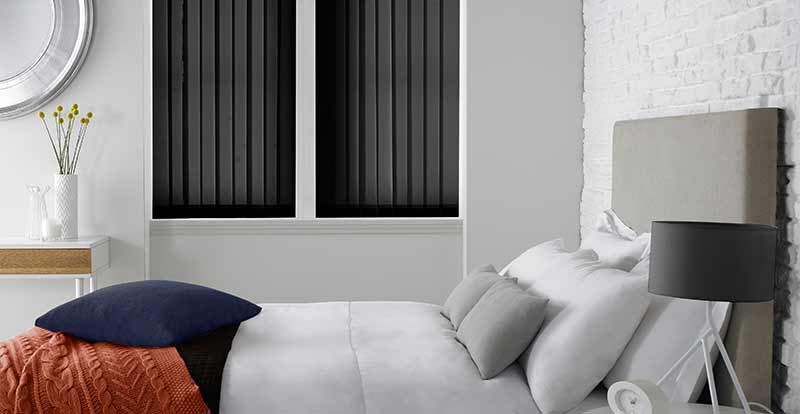 Black Vertica Blackout Blinds in a bedroom